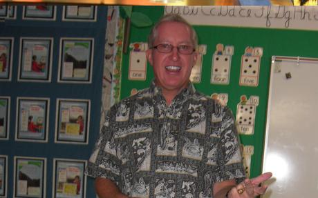 Mr. DuCharme smiles during a class lesson.
