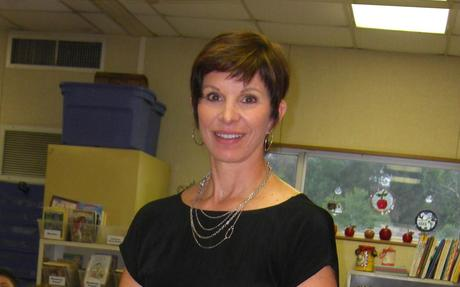 Mrs. Tatarian smiles while in her classroom.